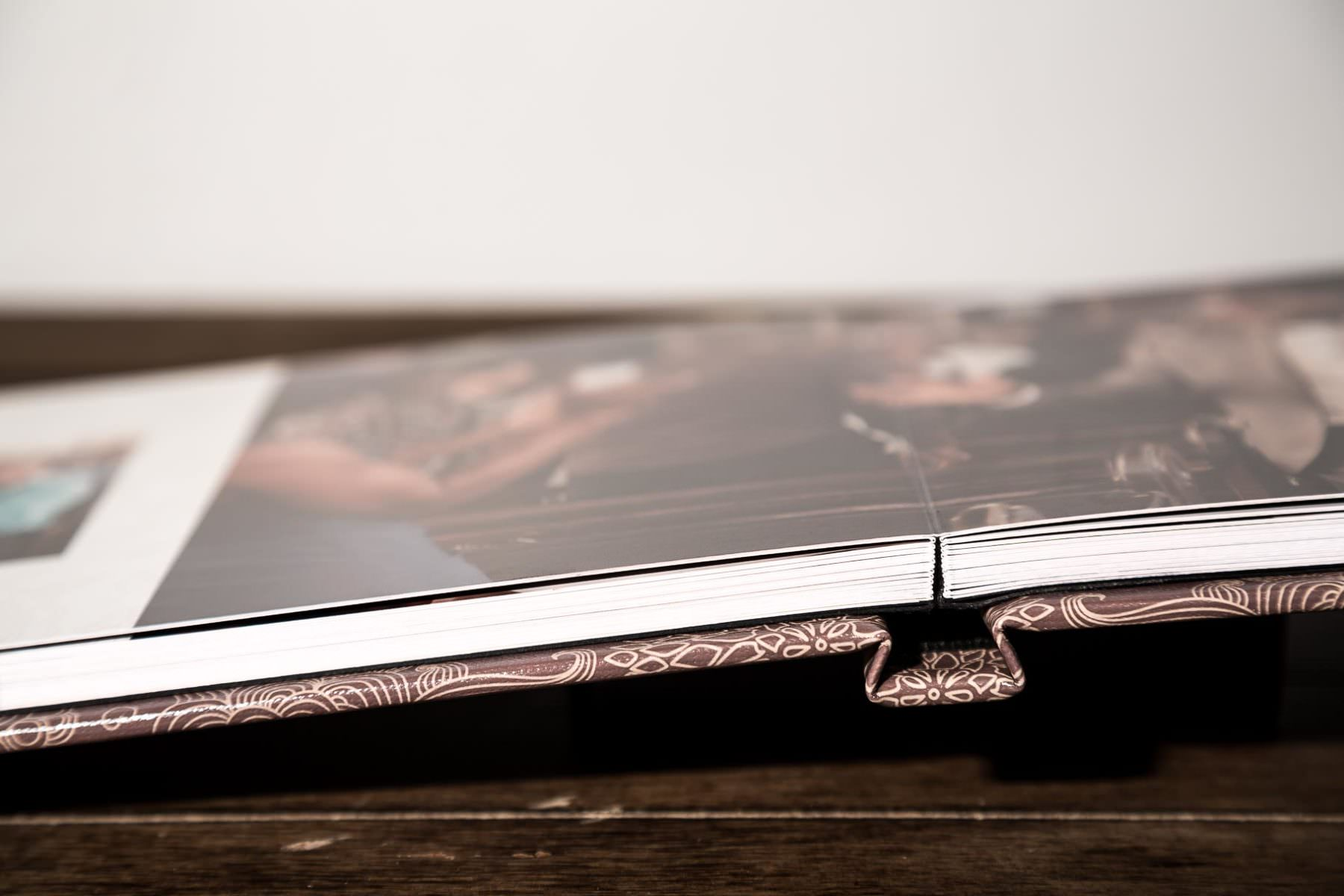 Handmade photo album with wedding photos included in price of select wedding packages